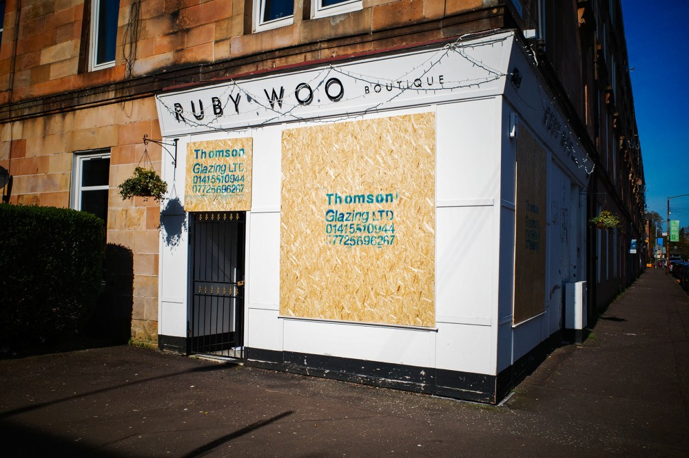 Boarded up shops in Glasgow
