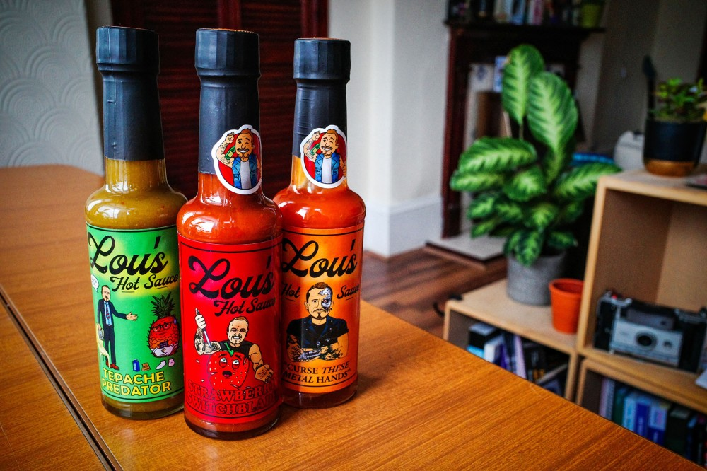 Lou's Hot sauce bottles